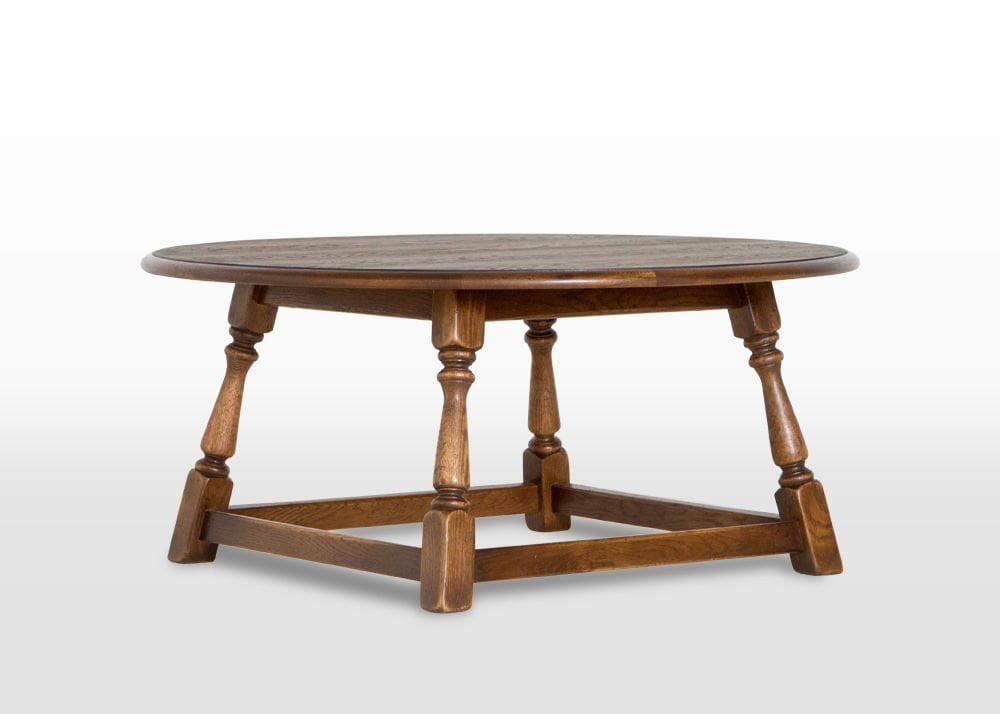 Old charm round coffee table wood bros for Light oak round coffee table